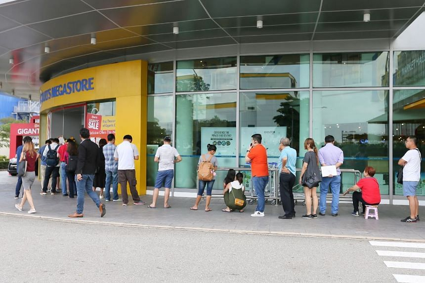The queue for the newly-announced Google Home and Google Home Mini at Courts Megastore, on April 20, 2018.