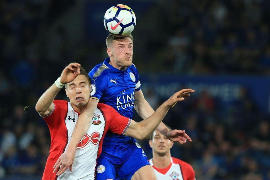 Southampton defender Jan Bednarek (left) vies with Leicester City striker Jamie Vardy.