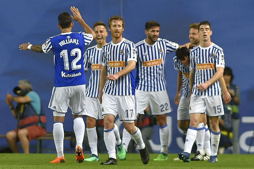 Real Sociedad players celebrate their second goal.