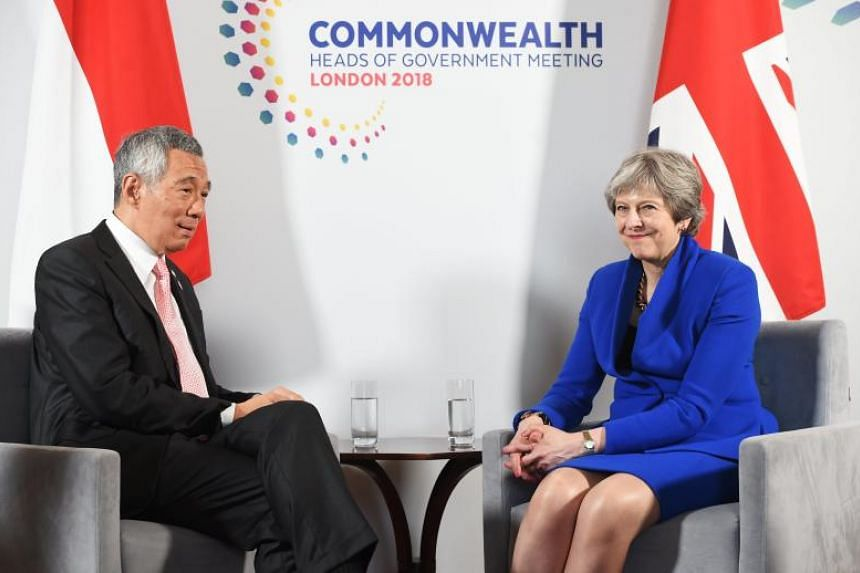 Prime Minister Lee Hsien Loong and British Prime Minister Theresa May (right) at the Commonwealth Heads of Government Meeting in Lancaster House in London, Britain, on April 19, 2018.