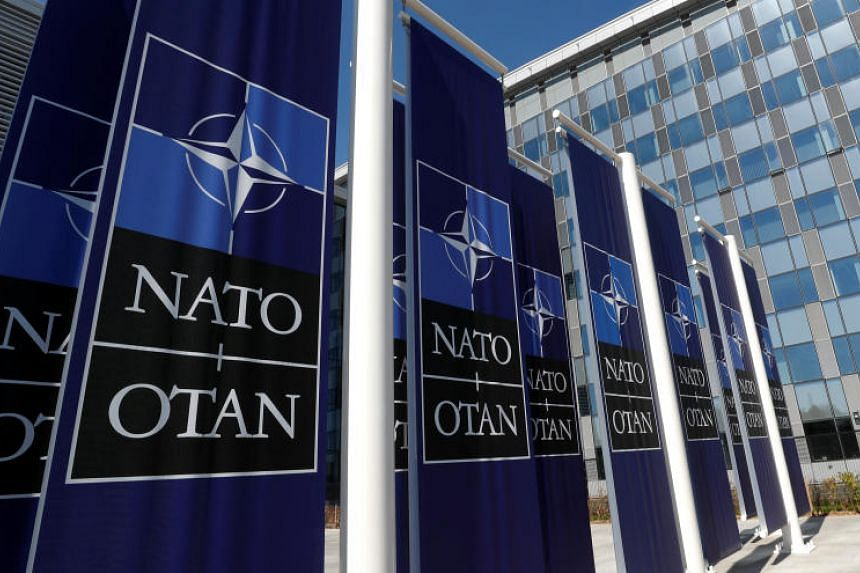 Banners displaying the Nato logo are placed at the entrance of new Nato headquarters during the move to the new building, in Brussels, Belgium on April 19, 2018.