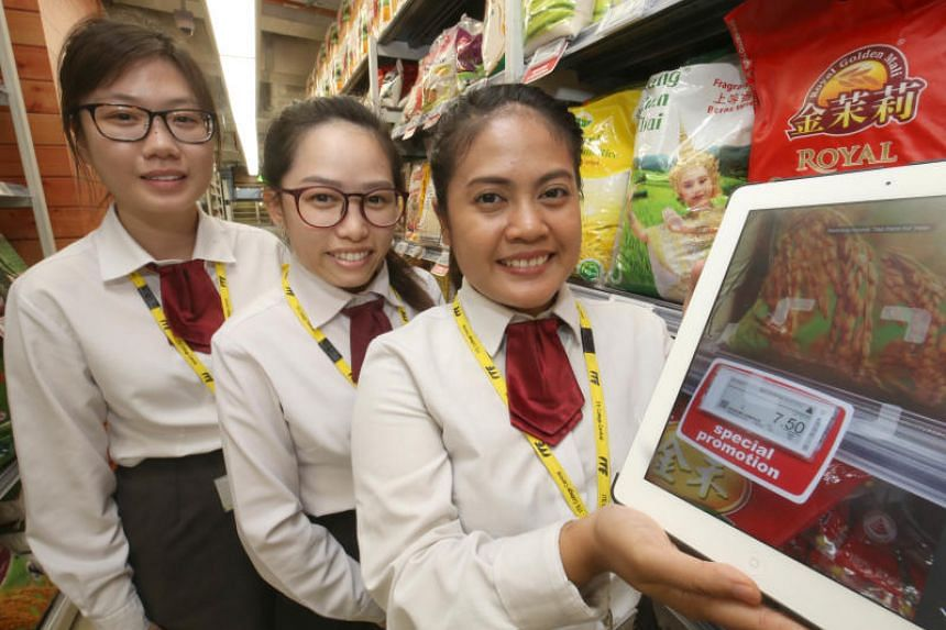 (From left) Rachel Foo Pei Qi, 20, Evonne Tay, 22 and Diny Arina Bte Rosman, 22 showcasing their QR code scanner at ITE Headquarters & College Central on April 20, 2018.