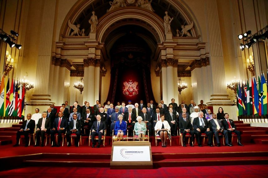 Commonwealth leaders pose for a family photograph with Britain's Queen Elizabeth during the formal opening of the Commonwealth Heads of Government Meeting in the ballroom at Buckingham Palace in London, Britain, on April 19, 2018.