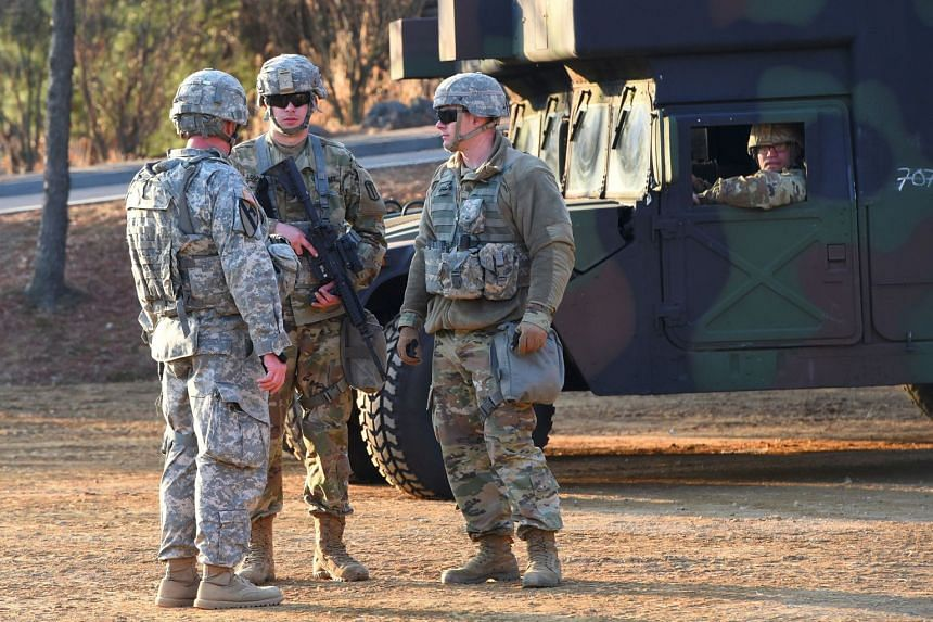 US soldiers standing guard during a joint medical evacuatioin exercise as part of the annual massive military exercises, known as Key Resolve and Foal Eagle, at a South Korean Army hospital in Goyang, north-west of Seoul, on March 15, 2017.