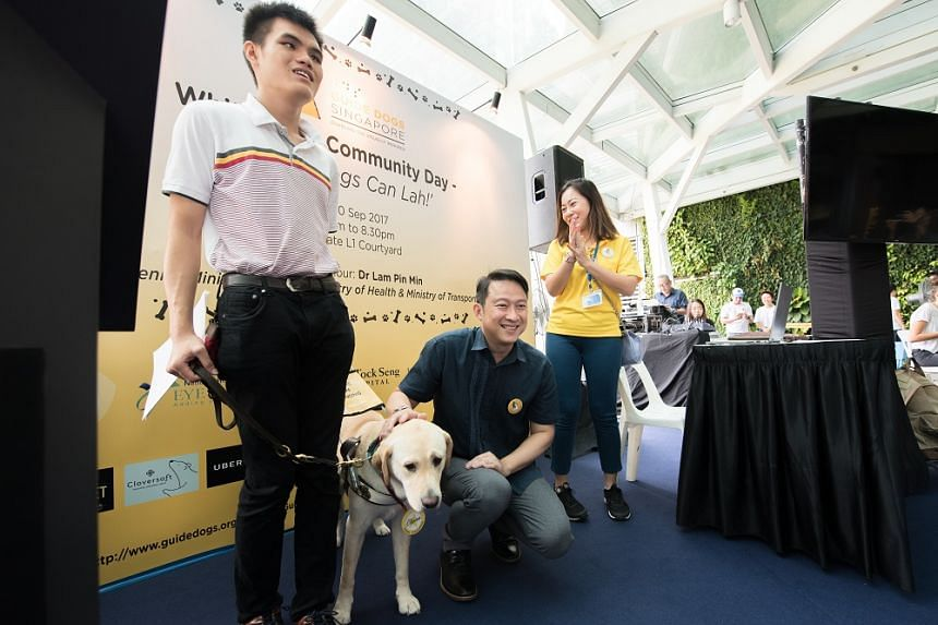Guide dog Clare with her handler Mr Chia Hong Sen, with Senior Minister of State for Health Lam Pin Min at a Guide Dogs Singapore event in 2017.