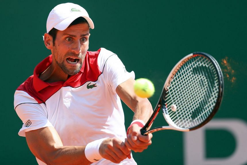 Djokovic returns the ball to Austria's Dominic Thiem during their Monte Carlo Masters match.
