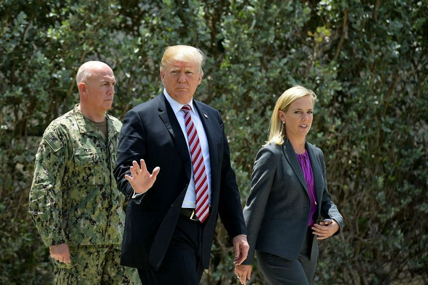 Trump walks with Admiral Kurt Walter Tidd, US Southern Commander,  and Homeland Security Secretary Kirstjen Nielsen on April 19, 2018.