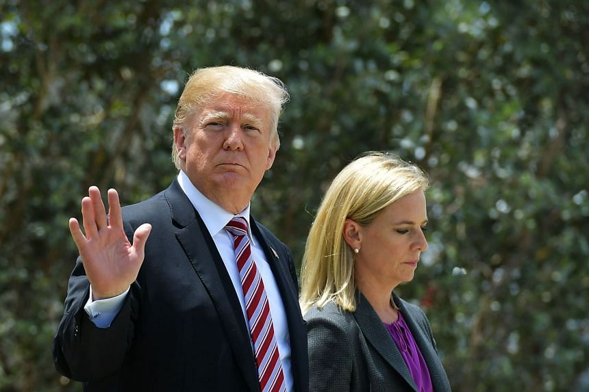 US President Donald Trump walks with Homeland Security Secretary Kirstjen Nielsen as he tours Joint Interagency Task Force South, a federal anti-smuggling and anti-drug trafficking agency, at the Naval Air Station Key West in Key West, Florida on Apr