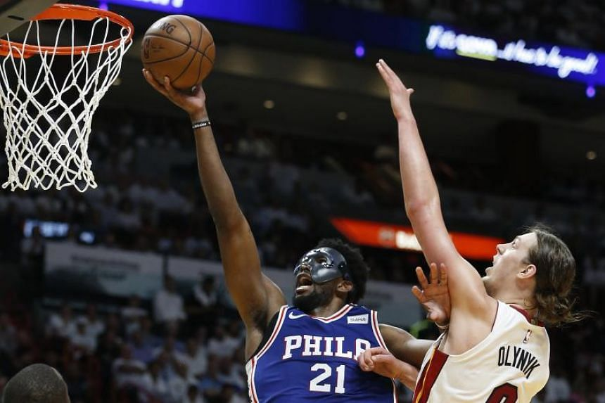 Philadelphia 76ers' Joel Embiid goes for the basket during the National Basketball Association game against Miami Heat at the American Airlines Arena in Miami on May 19, 2018.