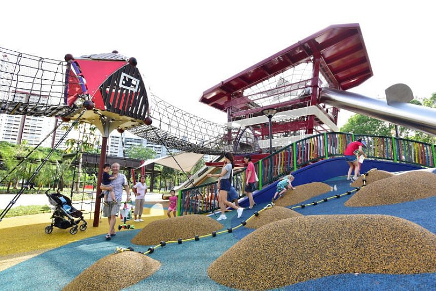 The playground at Marine Cove, includes a beach tower with multiple slides, climbing nets, and bridges.