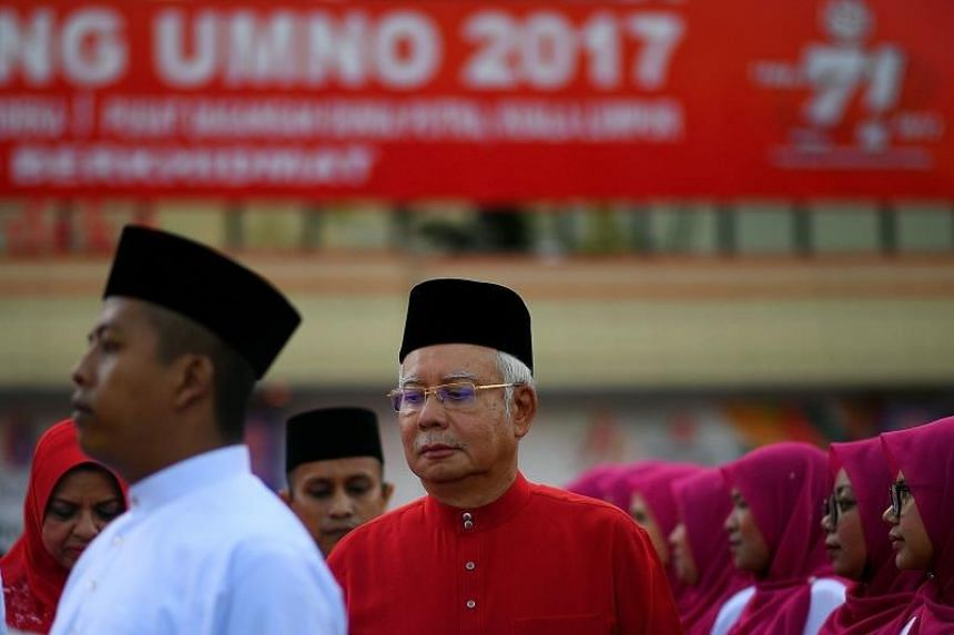 Malaysia's Prime Minister Najib Razak inspects a ceremonial guard of honour during the annual congress of his ruling party, the United Malays National Organisation (UMNO), in Kuala Lumpur on Dec 7, 2017.
