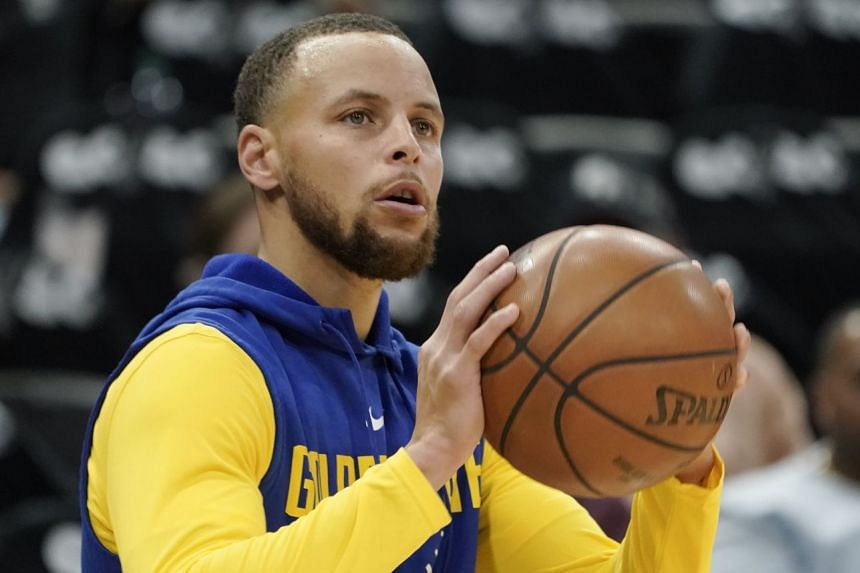 Stephen Curry of the Golden State Warriors warms up before a game.