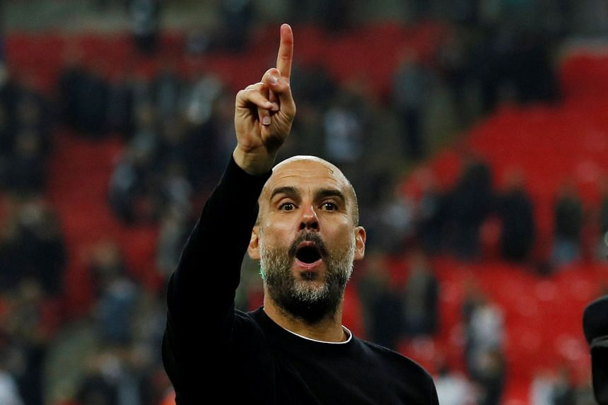 Manchester City manager Pep Guardiola celebrates after a match.