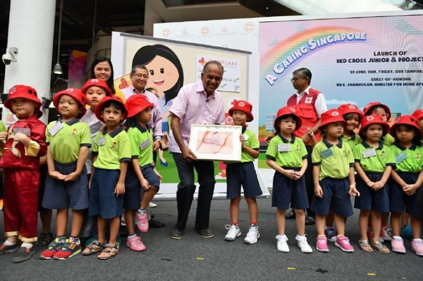 Minister for Home Affairs and Law K. Shanmugam at the launch of the Red Cross Junior Club.