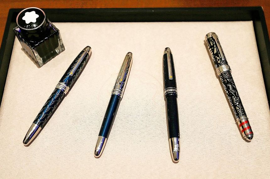 The writing instruments (above) from German luxury goods manufacturer Montblanc are often handcrafted with premium materials. South Africa-born craftsman Axel Nier (top) was in Singapore recently to showcase Montblanc's pen nibs, all of which are eng