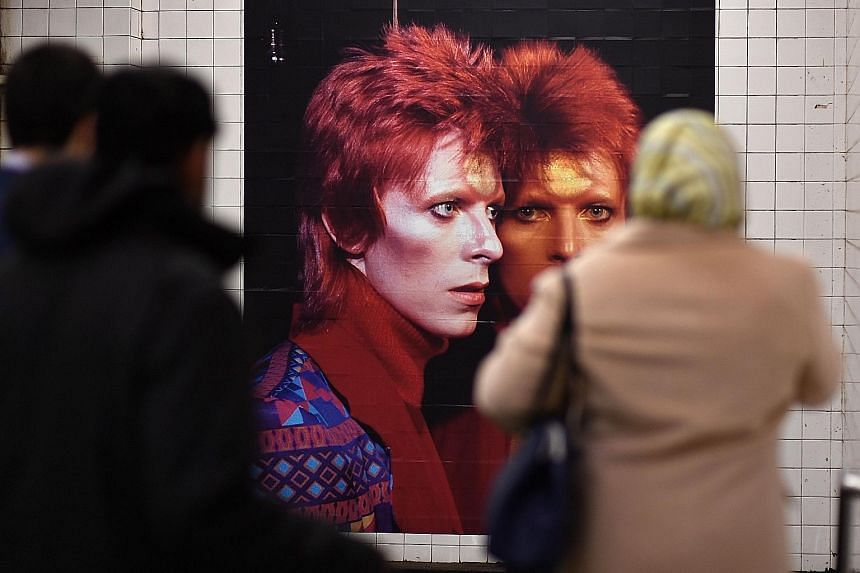 Photos and posters of David Bowie at the Broadway-Lafayette subway station in New York give commuters something to look at on their journey.