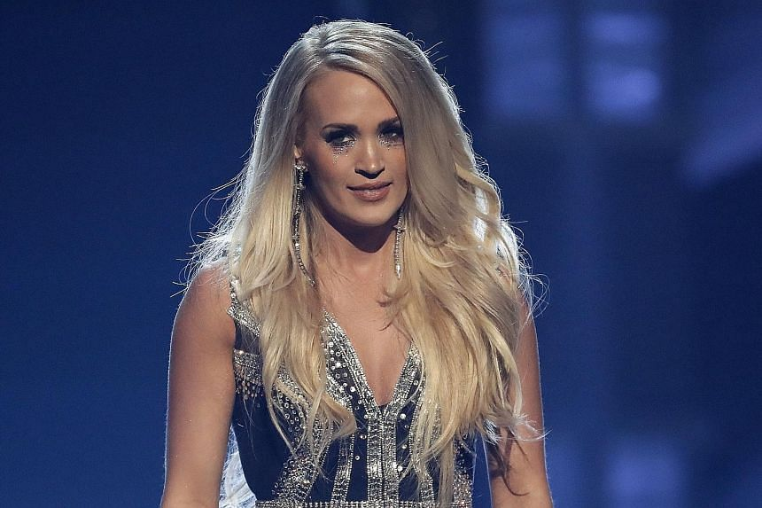 Carrie Underwood's face looked normal when she performed at the Academy of Country Music Awards on Sunday.