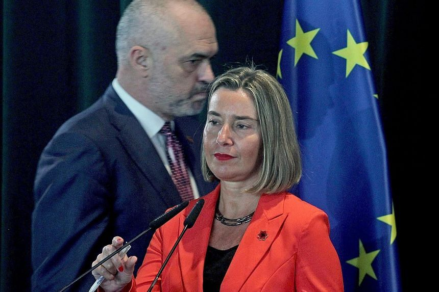 European Union foreign policy chief Federica Mogherini (front) and Albanian Prime Minister Edi Rama in Tirana, Albania. The move to start discussions for Albania to join the EU signals how the West is doing more to woo Balkan states away from Russian
