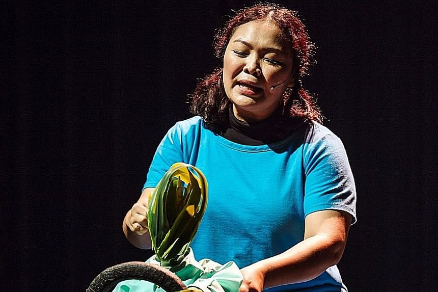 Actress Siti Khalijah Zainal riding a taxi in the one-woman show, How Did The Cat Get So Fat?.