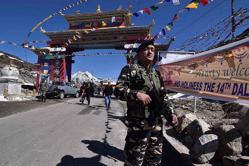 An Indian security guard near the Chinese border in India's north-eastern state of Arunachal Pradesh. India and China have had longstanding issues along their nearly 4,000km-long border, which is poorly demarcated in many parts. Border rows flare up