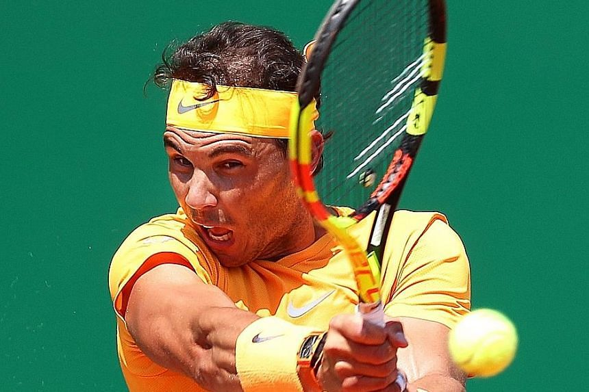 Rafael Nadal of Spain powering a backhand return in his dominant win over Dominic Thiem of Austria in the quarter-finals of the Monte Carlo Masters yesterday. He needs to win the tournament for an 11th time to stay top of the world rankings.
