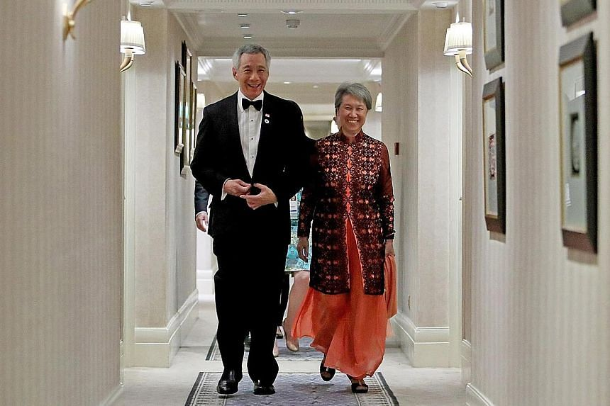 Above: Prime Minister Lee Hsien Loong and Mrs Lee on their way to the state dinner hosted by Britain's Queen Elizabeth II in London yesterday. Right: Queen Elizabeth II greeting Mr Lee in the Blue Drawing Room before The Queen's Dinner at Buckingham