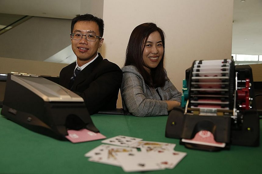 Casinos here use new technology to ensure honest gaming, said Mr Chan Wei Siang (far left), assistant director of gaming technology at the Casino Regulatory Authority, seen here with Ms He Shujia, head of inspection and compliance.