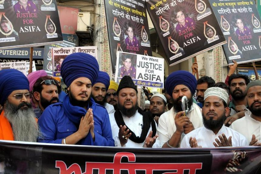 Members of Sikh and Muslim organisations take part in a prayer for victim of rape crime, 8-year-old Asifa, during a march and protest in Amritsar, India, on April 21, 2018.