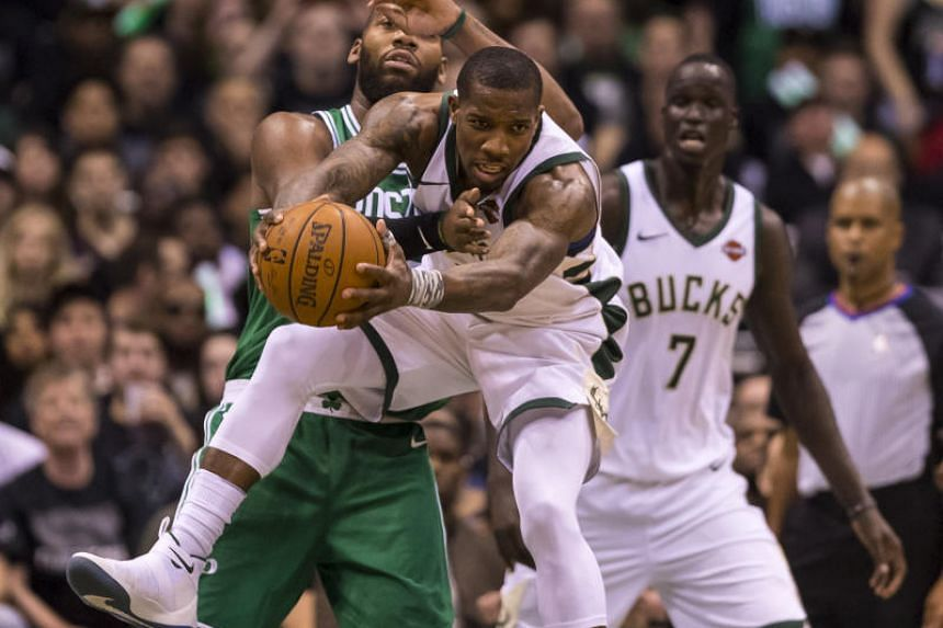 Milwaukee Bucks' Eric Bledsoe grabs a rebound in front of Boston Celtics' Greg Monroe during game three of the first round of the 2018 NBA Playoffs at BMO Harris Bradley Center in Milwaukee on April 20, 2018.