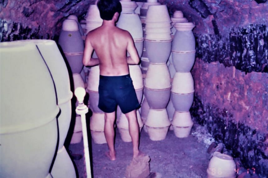 Workers from Sam Mui Kuang Pottery handmade and fired up 25kg stoneware jars at its 50m-long dragon kiln nefore water pipes started snaking through homes in Singapore.