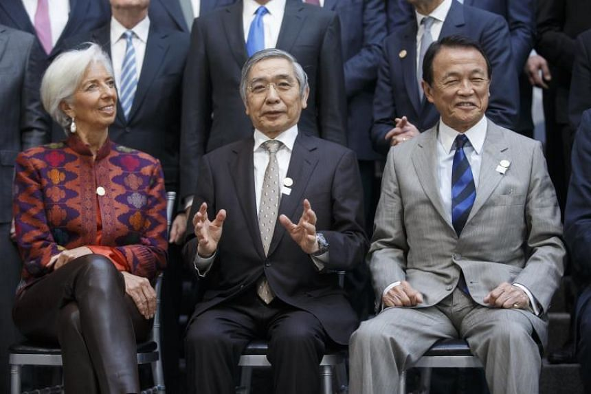 (From left) International Monetary Fund chief Christine Lagarde, Bank of Japan governor Haruhiko Kuroda and Japan's Finance Minister Taro Aso pose for a group photo of G-20 Finance Ministers and Central Bank Governors in Washington, DC, on April 20,