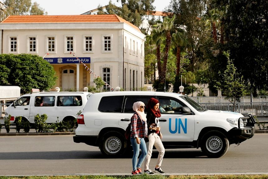 A United Nation vehicle carrying the Organisation for the Prohibition of Chemical Weapons inspectors is seen in Damascus on April 17, 2018.