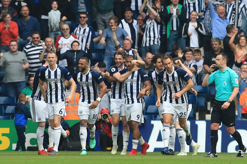 West Bromwich Albion striker Salomon Rondon (centre) celebrates with his teammates after scoring their second goal to equalise 2-2 during the English Premier League match against Liverpool at The Hawthorns in West Bromwich on April 21, 2018.