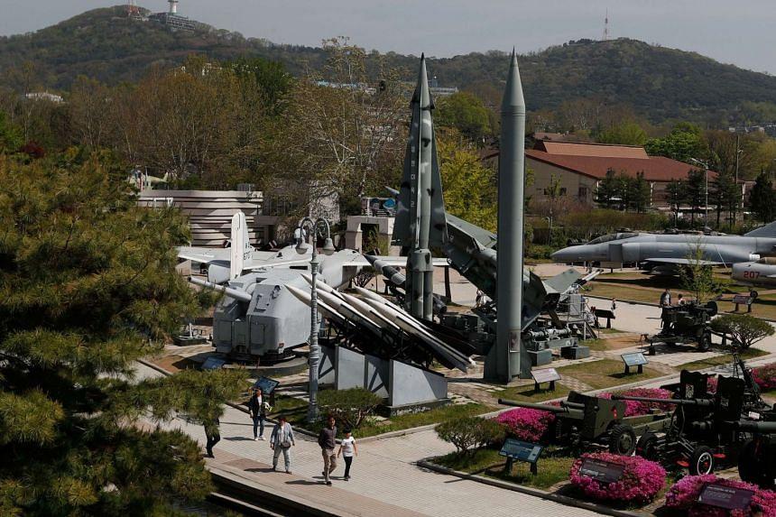 Visitors look at a North Korean Scud-B Tactical Ballistic Missile on display at the Korean War Memorial Museum in Seoul, South Korea, on April 21, 2018.