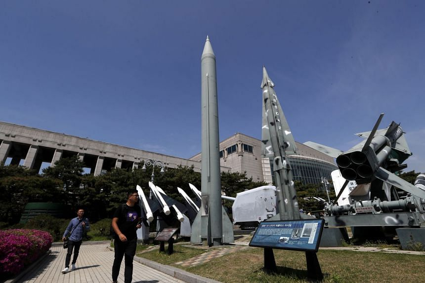 Visitors looking at a North Korean Scud-B Tactical Ballistic Missile on display at the Korean War Memorial Museum in Seoul, South Korea, on April 21, 2018.