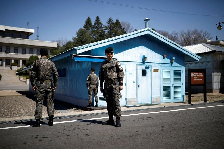 South Korean soldiers standing guard at the truce village of Panmunjom inside the demilitarised zone separating the two Koreas, South Korea, on April 11, 2018.