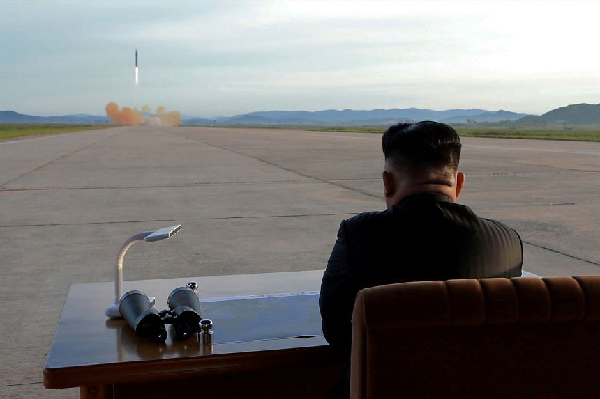 A file photo of North Korean leader Kim Jong Un watching the launch of a Hwasong-12 missile in this undated photo released by North Korea's Korean Central News Agency (KCNA), on Sept 16, 2017.