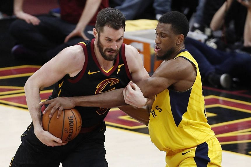Indiana Pacers forward Thaddeus Young (right) reaches in against Cleveland Cavaliers center Kevin Love (left) during the second half of the NBA Eastern Conference First Round Playoffs game 2, on April 18, 2018.