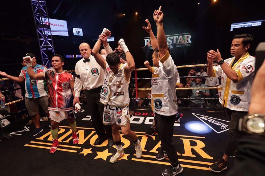 Singapore's Muhamad Ridhwan beat Filipino Jeson Umbal in their International Boxing Organisation intercontinental featherweight title bout.