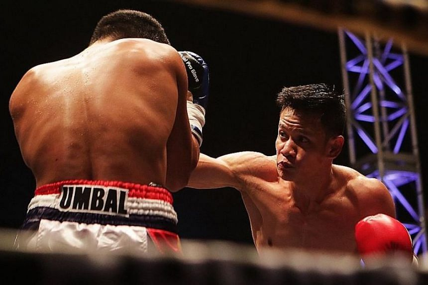 Singapore's Muhamad Ridhwan throwing a punch at Filipino Jeson Umbal during their International Boxing Organisation intercontinental featherweight title bout.