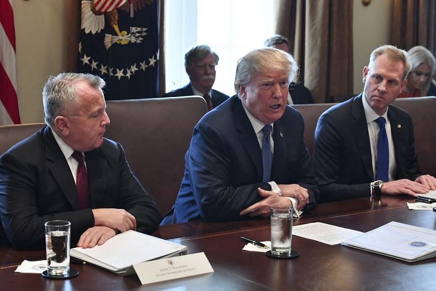Trump (centre) with Sullivan (left) and Deputy Secretary of Defence Patrick Shanahan, durinng a Cabinet meeting.