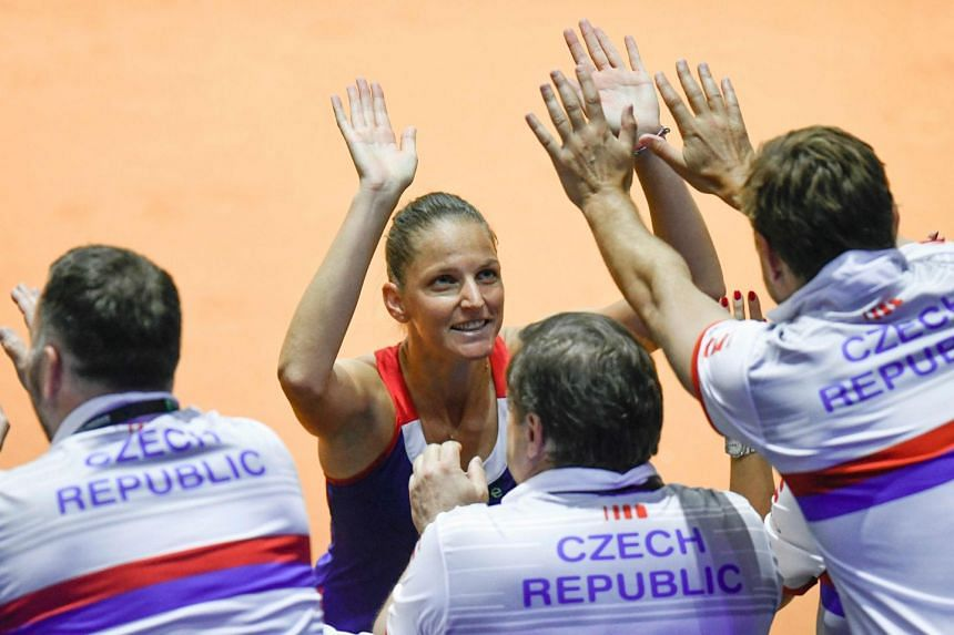 Pliskova celebrates with team members after defeating Germany's Angelique Kerber.