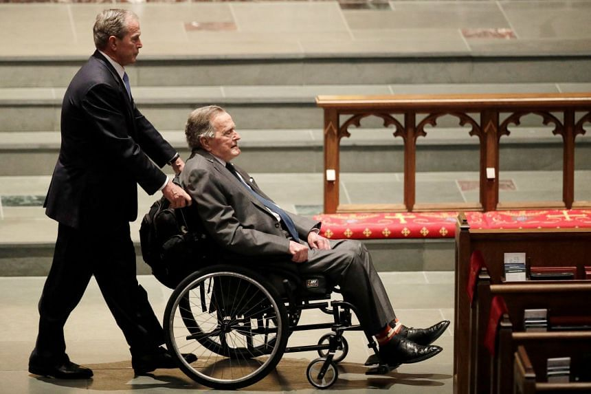 Former presidents George W. Bush, and George HW Bush arrive at St Martin's Episcopal Church.