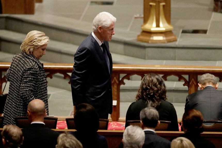 Former first lady Hillary Clinton and former president Bill Clinton arrive at St Martin's Episcopal Church.