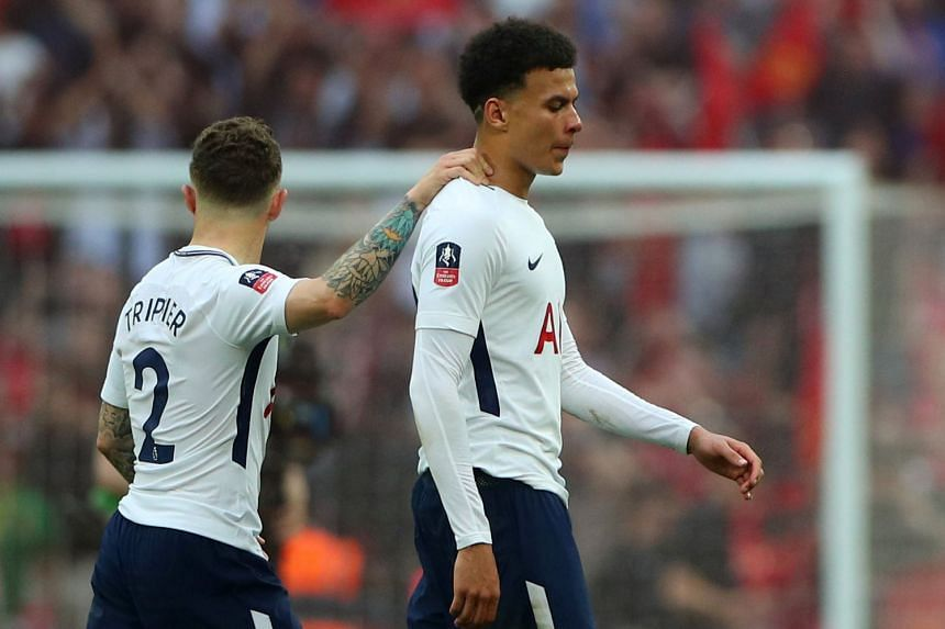 Tottenham's Dele Alli looks dejected and is comforted by Kieran Trippier at the end of the match