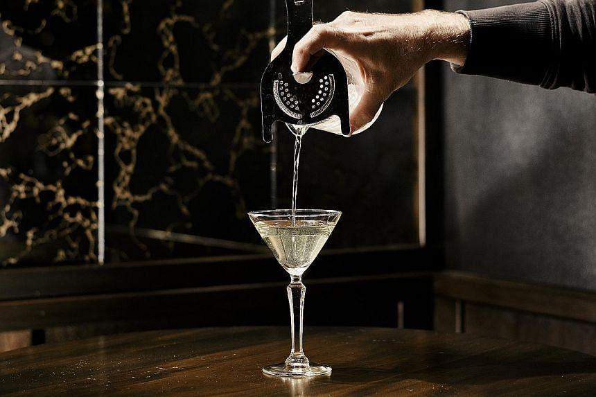 An Alaska cocktail being poured at Golden Teardrops, a subterranean cocktail bar in Chicago.