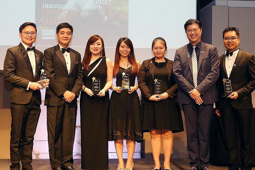 The winners of the Financial Planning Association of Singapore (FPAS) Financial Planner Awards include (from left) Mr Colin Lai (financial advisory - rising star), Ms Goh Ming Shan (insurance - rising star), Ms Kaylyn Heng (banking - rising star), Ms
