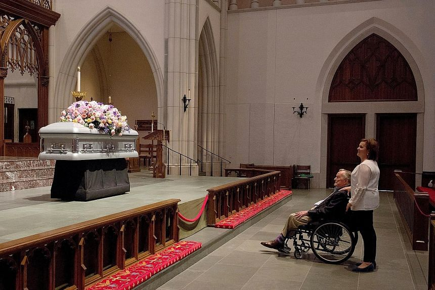 Former US president George H.W. Bush looking at the casket of his late wife, former first lady Barbara Bush, with his daughter Dorothy Bush Koch during the visitation at St Martin's Episcopal Church in Houston, Texas, on Friday. Former United States