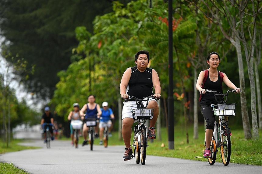 Gary Lim and Sherlyn Lee cycling towards Punggol Settlement for the Eat and Ride programme, which is the first build-up activity for The Straits Times Run on Sept 23 at the Singapore Sports Hub
