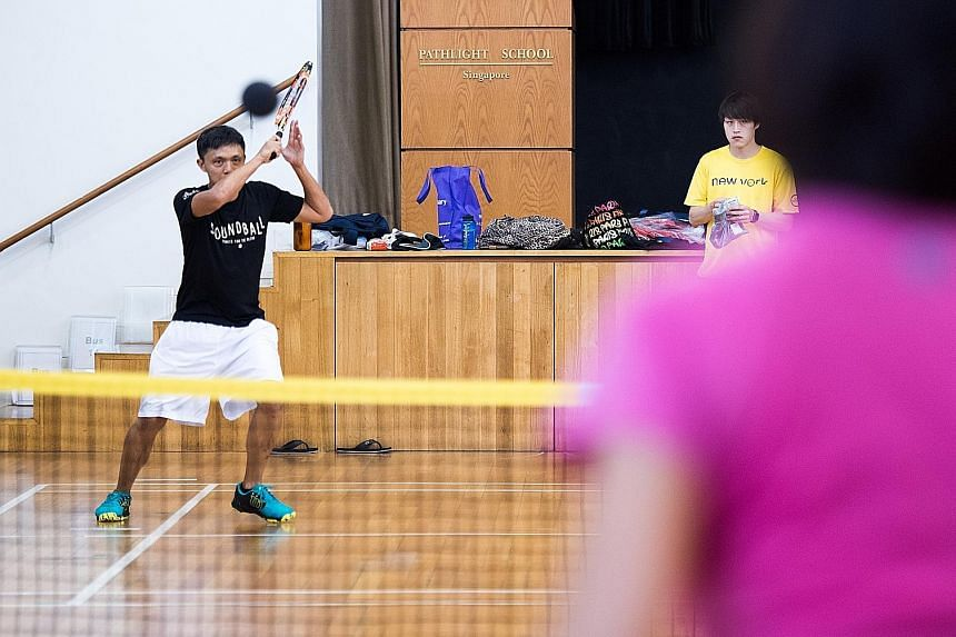 Marc Chiang hitting a return in soundball. The sport utilises a sponge ball filled with ball bearings, which enables blind players to know that they have kept the ball in play and hear where it is.